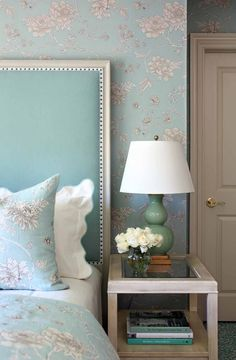 Isn't this a dreamy palette for a bedroom? We love the headboard, luxe wallpaper and pretty bedding!