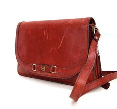 Molly, French Vintage, 1960s Ox-Blood Leather Satchel, Messenger Handbag from Paris. $78.00, via Etsy.