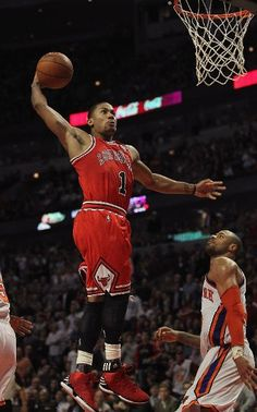 CHICAGO, IL - MARCH 12: Derrick Rose #1 of the Chicago Bulls goes up for a dunk over Tyson Chandler #6 of the New York Knicks on his way to a game-high 32 points at the United Center on March 12, 2012 in Chicago, Illinois. The Bulls defeated the Knicks 104-99. (Photo by Jonathan Daniel/Getty Images)