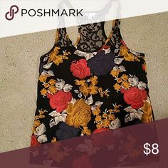 Floral print tank top. Beautiful lace back floral tank top. Goes with so many things! I've worn it with a black skirt, mustard pants, jeans, khakis. The possibilities are endless! Tops Tank Tops