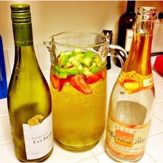 Chardonnay Sangria - 1 bottle chardonnay, 1 bottle Amour de Paris Peach Champagne (Trader Joes), green apples, strawberries, and green grapes