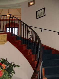 """Haunted spiral stairs, Punderson Manor, Geauga County, Ohio. In addition to Park Rangers who witnessed strange laughter and cold spots, the night auditor claimed she saw a female apparition """"wearing an old-fashioned, bluish grey cape and bonnet and floor-length dress.""""  The woman in Civil-War era clothing then floated up the stairs and left behind ice-cold air. The employee also witnessed the same female apparition several times later."""