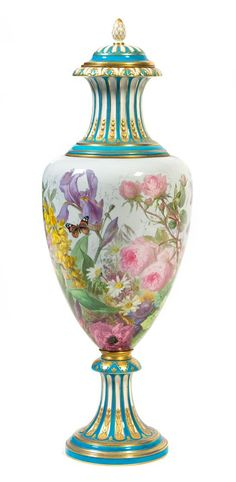 A Sevres Style Porcelain Urn and Cover Height 38 inches.