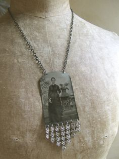 Altered Art NecklaceFrom AnAlteredAffair...  My friend Nanci has made earrings from tin type photographs