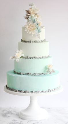 This blue ombre wedding cake by Winifred Kriste Cake is perfect for a Frozen or winter wonderland wedding! Get inspired by more amazing wedding cakes in the feature! Beautiful Wedding Cakes, Gorgeous Cakes, Pretty Cakes, Amazing Cakes, Perfect Wedding, Cakes To Make, Fancy Cakes, Wedding Cake Designs, Wedding Cake Toppers