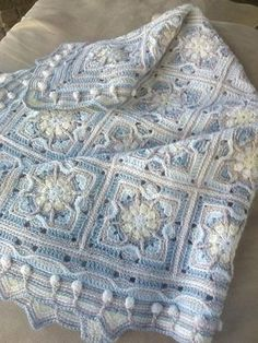 This baby blanket is worked in overlay crochet technique.