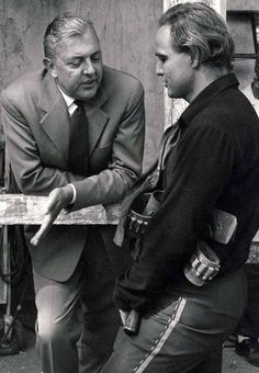 Jacques Tati chatting with Marlon Brando on the set of One-Eyed Jacks.  Directed by Brando, 1961.
