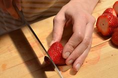 Then cut off a tiny part of the tip so that strawberry can stand upright.   How To Make Strawberry Margarita JelloShots