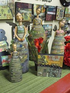 Kelly Rae Robert's figurines and plaques