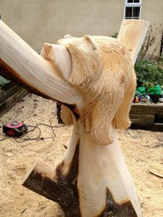 Chainsaw carved sleeping bear - photo by aaronpatty, via photobucket