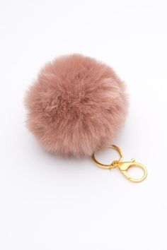 The hottest new fall accessory, a blush pom pom key chain!
