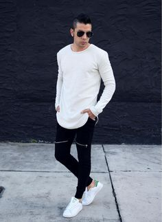 Dress in a white long sleeve t-shirt and black track pants for a comfy-casual look. A pair of white low top sneakers will bring a strong and masculine feel to any ensemble.   Shop this look on Lookastic: https://lookastic.com/men/looks/white-long-sleeve-t-shirt-black-sweatpants-white-low-top-sneakers/15337   — White Long Sleeve T-Shirt  — White Low Top Sneakers  — Black Sunglasses  — Black Sweatpants