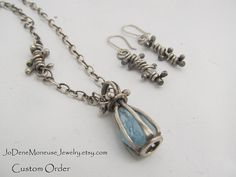Aquamarine in a cage-Custom RESERVED order in sterling silver by JoDeneMoneuseJewelry