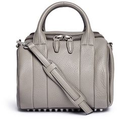 Alexander Wang 'Rockie' pebbled leather duffle bag ($720) ❤ liked on Polyvore featuring bags, handbags, grey, alexander wang handbags, alexander wang bag, duffle bag, grey purse and studded handbags