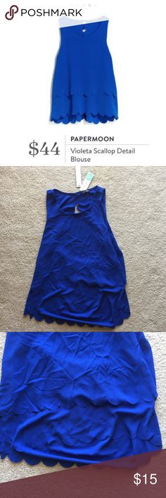 NWT Papermoon Blue Scalloped Open Back Blouse NWT Papermoon Blue Scalloped Open Back Blouse • Size: MP • Blue Blouse with tiered scalloped layers • back is covered with overlapping scalloped trim fabric • from Stitch Fix! • new with tags! • 96% rayon, 4% polyester Papermoon Tops Blouses
