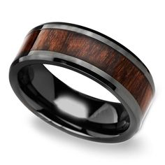 This black ceramic men's wedding band features a warm Carpathian wood inlay with beveled edges and a comfort fit.