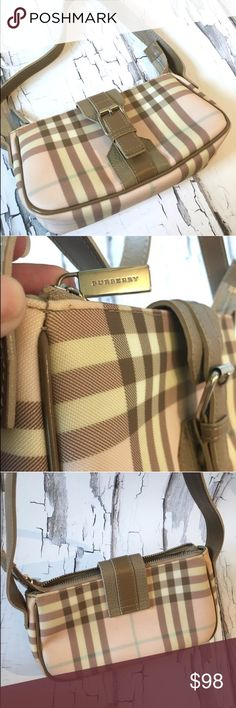 Burberry Pink Nova Check mini bag Authentic. A few tiny marks on the bottom but other than that in EUC. This is a heavy coated pvc material. It zips closed and has all silver Burberry logo hardware. Zip pull has logo on both sides. More  pictures can be provided if need be. Big enough to hold a cell phone and several other essential items. No bundling please. Burberry Bags Mini Bags