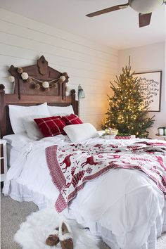 This clean and cozy Christmas bedroom makes staying in bed all day that much easier.
