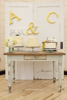 Vintage & Whimsical wedding cake table with old white washed barn doors and an old white washed desk