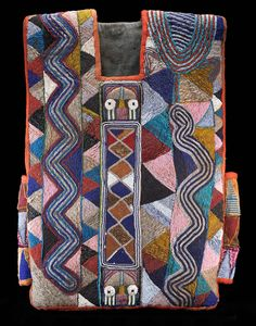 Tunic for Shango priest,  Possibly Baba Adesina family workshop, Yoruba peoples, Nigeria // Early 20th century Cotton, glass beads //  National Museum of African Art, Smithsonian Institution, museum purchase, 2003-8-1 Photograph by Franko Khoury