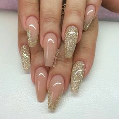 Nude light tan color and gold glitter polish with gel polished nails