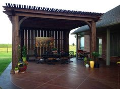 Red Rock Landscape & Design, LLC 20x20 pergola, wind break wall with scored and stained concrete.