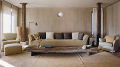 The penthouse drawing room of the Axel Vervoordt-designed Greenwich Hotel, with its oculus window, was designed as a meditation space. The vast coffee table was the first piece acquired f...