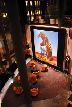 """""""The Horse Thief"""" by artist Richard Prince is among a wide-ranging collection of modern art on display in The Thief, Oslo's hot, new hotel."""