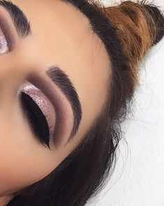 Pink eye look with dark cut crease.
