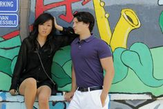Grand Rapids lifestyle, style and fashion blogger and designer - Downtown Grand Rapids urban Heartside; her - black shorts, black leather blouse; him - khaki shorts, purple polo