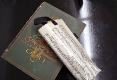 Wine bottle bag mad out of old music notes
