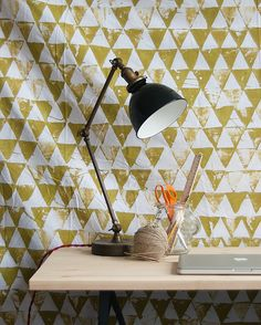 Transform an old bed sheet into a homemade geometric wall hanging.