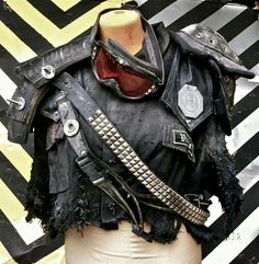 steampunk crop to motorcycle jacket with goggles.