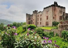 Muncaster Castle in Cumbria looms over Eskdale, a craggy fortress that could come straight...