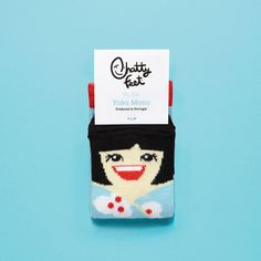 Yoko Jr is the best pair of socks for if you're feeling gloomy. With her happy face and love of telling jokes these jolly socks are sure to leave you grinning from ear to ear.