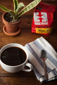 A cup of hot organic coffe with a napkin, spoon and bag of Organic Breakfast Blend. Fair Trade Coffee, School Fundraisers, Coffee Beans, Organic, Napkin, Breakfast, Tableware, Fundraising, Spotlight