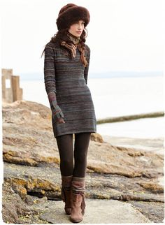 Earthy, heathered plum and denim are knit into a rich, striated landscape. Our long, easy tunic, in cotton (39%), baby alpaca (38%), wool (14%), alpaca (6%) and silk (3%), has a rounded neckline and ¾-sleeves.