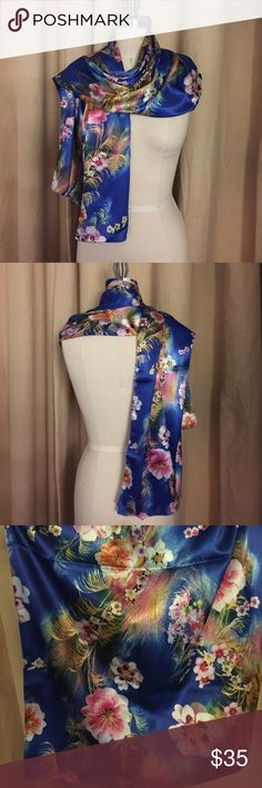 """Floral silk scarf 100% silk scarf with multi color floral print. Can be worn multiple ways and is reversible. The print on each side is different allowing more versatility. New never been worn. Dimensions: 29"""" x 60"""" Accessories Scarves & Wraps"""