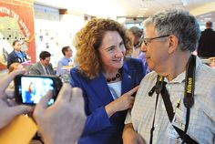 Waterbury--Elizabeth Esty of Cheshire chats with delegate Martin Cobern of Cheshire at the district 5 convention at Rotella Interdistrict Magnet School in Waterbury. Peter Casolino/New Haven Registe Cheshire Chat, Magnet School, Esty, Connecticut, Politics, Political Books