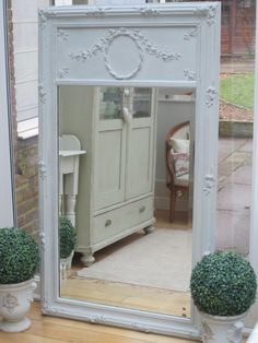 A lovely 19th century French trumeau mirror painted in a mixture of Paris Grey and Original Chalk Paint (TM) by Annie Sloan