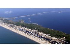 I've never seen this place so flat.  Must be shortly after Hurricane Dennis.  St. George Island and the St. George Island Bridge are seen in July 2005. St. George Island State Park: Entertainment Photo : The News Herald