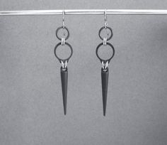 These industrial spike earrings are made with black retaining ring hardware, matte black acrylic spikes, and stainless steel jump rings. The ear wires are hypoallergenic titanium. Circle Earrings, Unique Earrings, Dangle Earrings, Metal Jewelry, Body Jewelry, Jewellery, Jewelry Box, Industrial Earrings, Industrial Metal