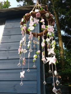 Hanging flowers and butterflies mobile made from felt and tiny beads