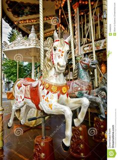 Carousel Horse On Old Amusement Merry Go Round Royalty Free Stock .