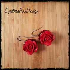 Check out this item in my Etsy shop https://www.etsy.com/listing/510501843/red-rose-earrings-cinnabar-jewelry-foxxy