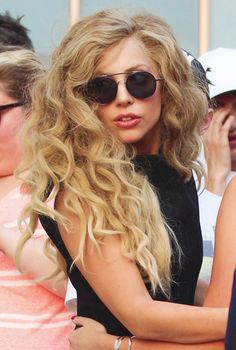 such beautiful waves on lady gaga... she is dressed normally for once and looking wow in her round sunglasses...