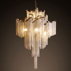 Take the mystical feelings associated with Atlantis, and place them in your home - in the form of a flowing, aluminum tassel chandelier! This chandelier is dressed up in hundreds of little aluminum ta Luxury Chandelier, Modern Chandelier, Chandelier Lighting, Art Deco Chandelier, Round Chandelier, Art Deco Lamps, Glass Chandelier, Industrial Hanging Lights, Led Pendant Lights
