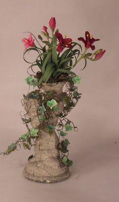 Daylilies in Cherub Statue by Marie Petrik