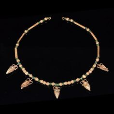 Perhaps the greatest charm of this truly lovely Greek necklace is the different shaped gold beads that constitutes most of the composition. Featured in the centre of the necklace are five gold double