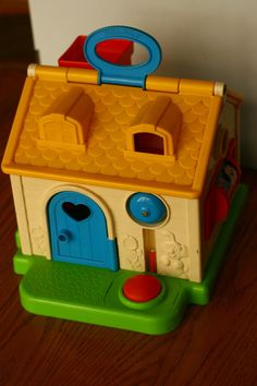 Vintage 1984 Fisher Price Toy House 80s by vintageatmosphere My babies enjoyed this. Lid lifts up to put plastic person to bed. Door opens with person inside, bell rings. Put person in the chimney and they come out the front door. Easy-carry handle. If you can find one on craigslist or e-bay--buy it.